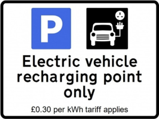 A range of electric vehicle charging point signs with tariff charge